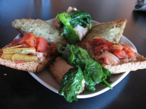 Rosemary foccacia toasted with artichoke garlic, hummus + sauteed greens, & roasted tomato fennel
