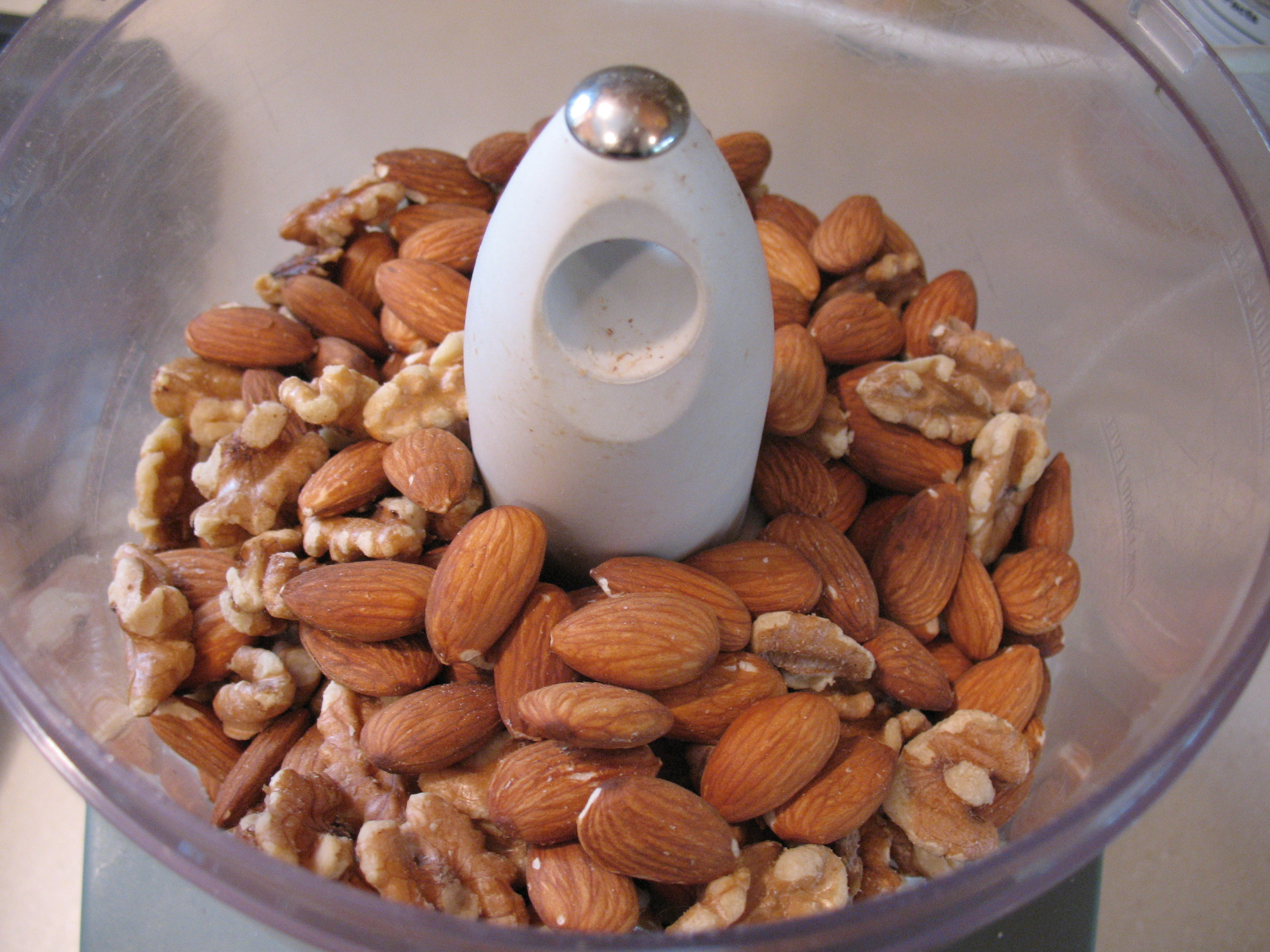 Roasted almonds and walnuts into the food processor.