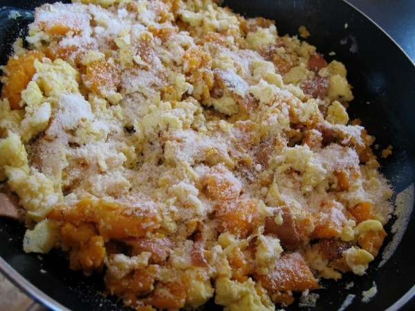4 eggs scrambled with 1/4 cup coconut milk, 1/2 large baked sweet potato, and topped with Parm.