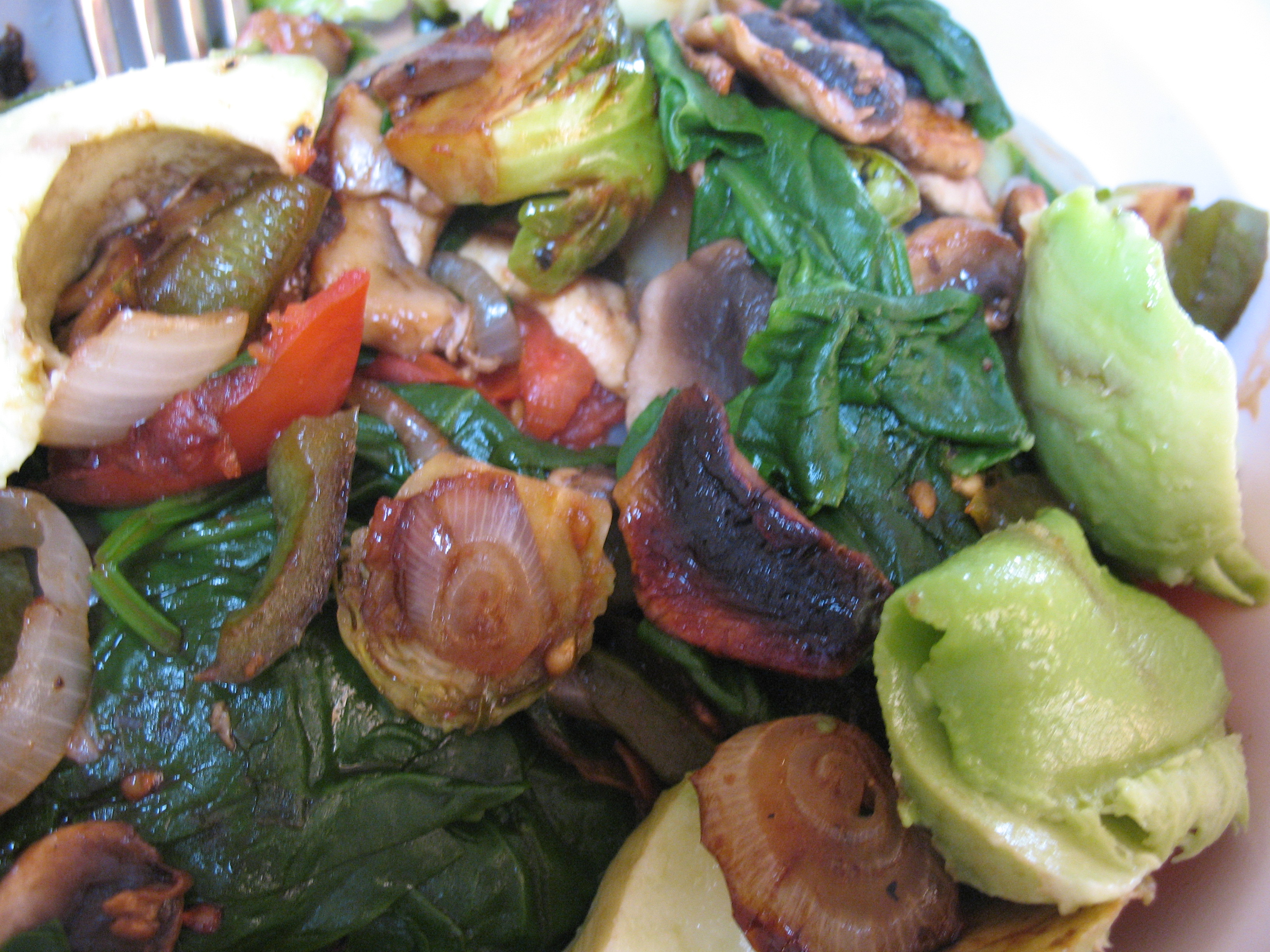Veggie stir-fry with chopped avocado.