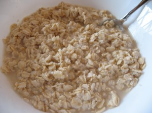 1 cup rolled oats soaked in boiling water until thick and creamy.  I love them plain.
