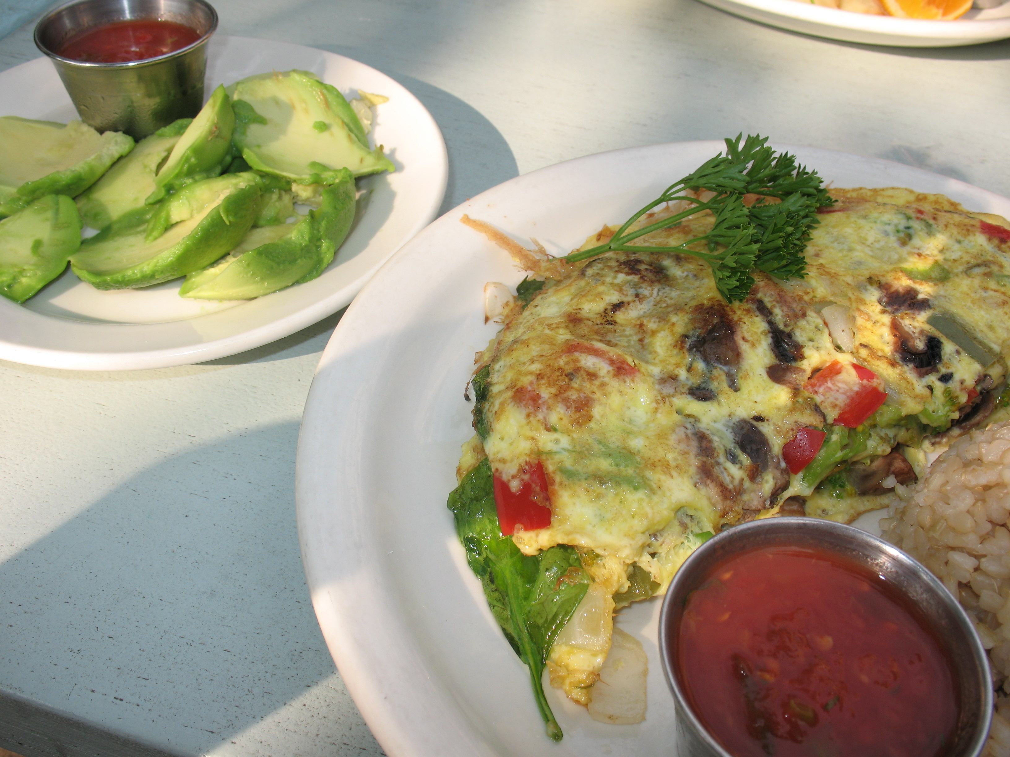Veggie omelet sans cheese with brown rice, salsa, and avocado on the side.