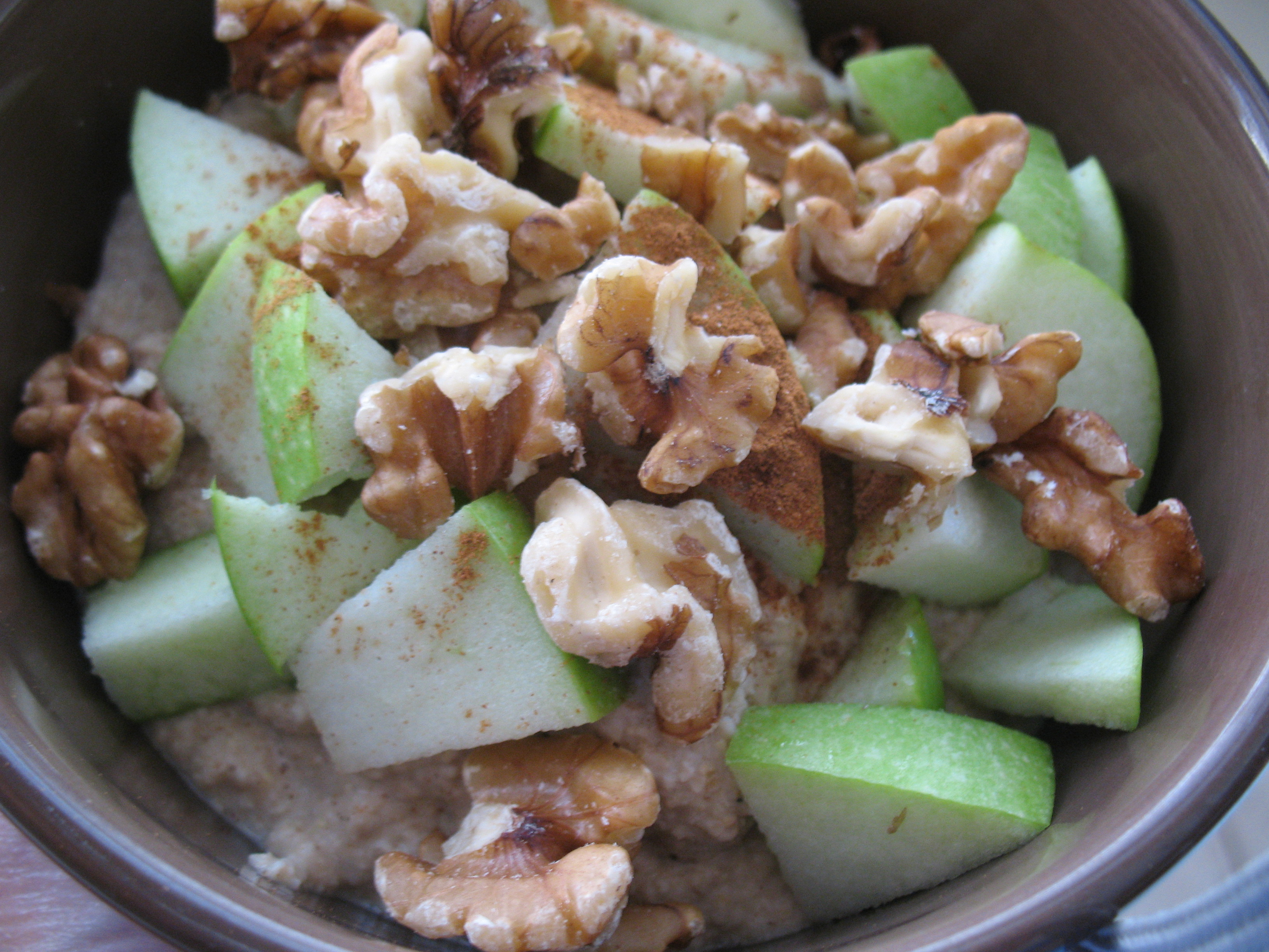 Fall themed oat bran: vanilla protein oats topped with apple, walnuts, & cinnamon.