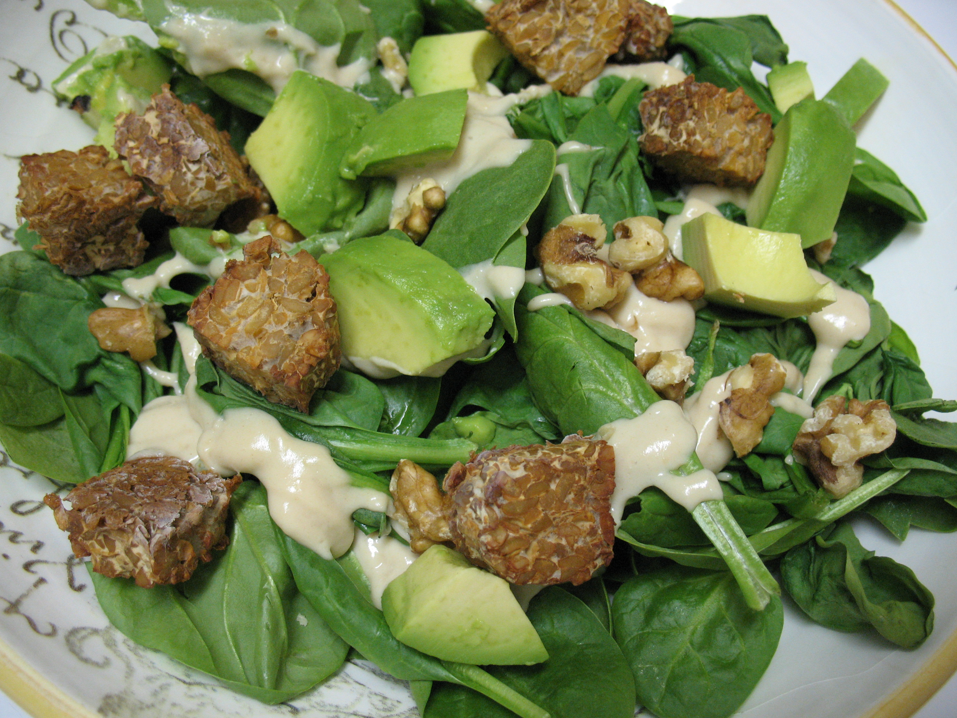 Spinach, roasted tempeh, avocado, walnuts, & my new favorite salad dressing..