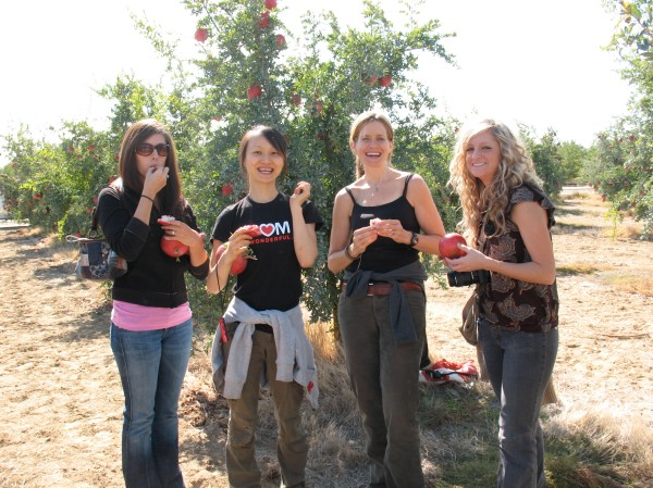 Me and the girls enjoying are fresh picked pomegranates.