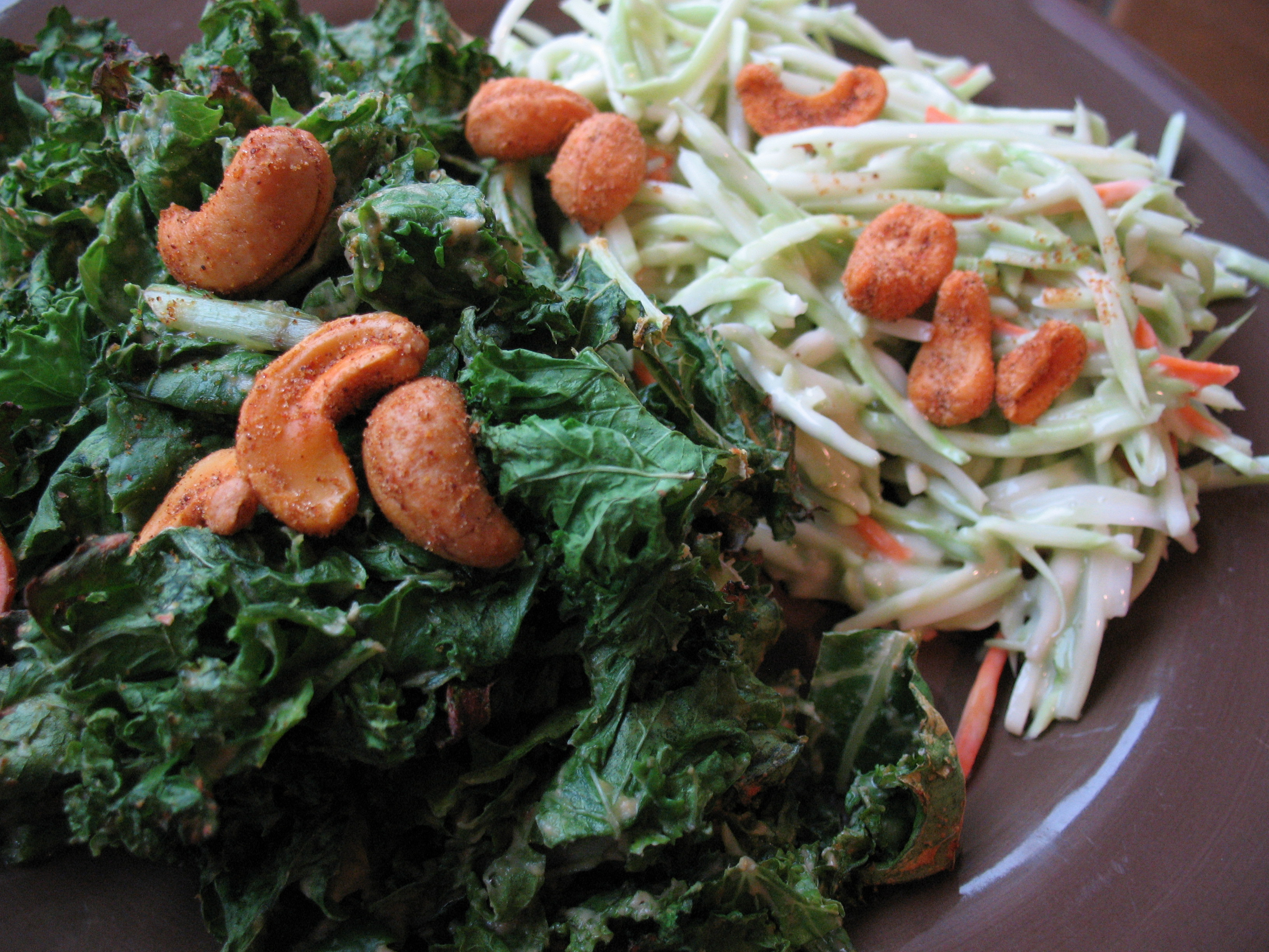 Plate of greens, slaw and nuts